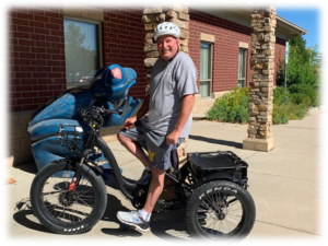 Bill Ludlow on his power road trike in front of The Sight Center